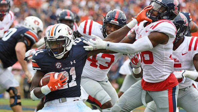 Auburn, seen here in last season's 44-23 win over Ole Miss, travels to Oxford Oct. 20 for an 11 a.m. kickoff on ESPN.