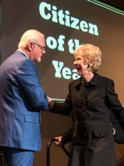 Mike Boyd welcomes Elta Joyce Murphey McAfee to the stage. McAfee was named 2016 Citizen of the Year by the San Angelo Chamber of Commerce.