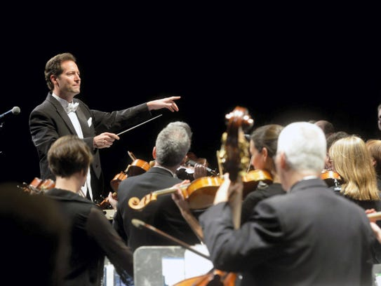 Lawrence Golan directs 77 musicians performing in his