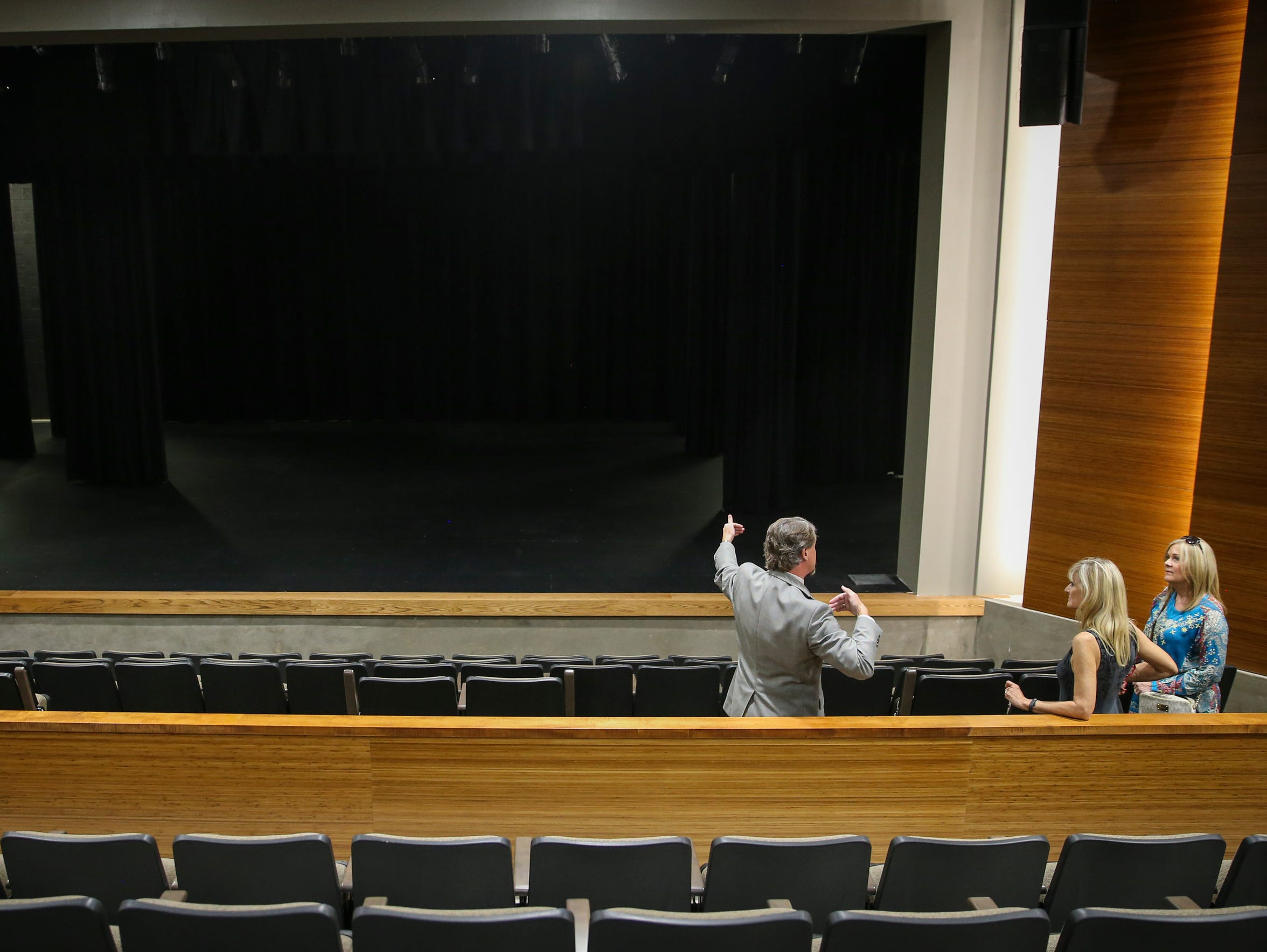 Andrew Graves tours the theater with Elaine Stribling,