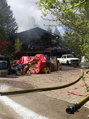 A residential fire destroyed a home on the 2700 block of Lake Ridge Shores Drive in Reno on April 25, 2016.
