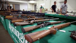 Rifles are seen on display at Ron Martin's booth at