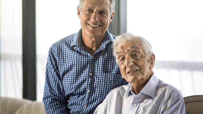 World War II veteran William Langfan inside his Palm Beach home with his son Mark.