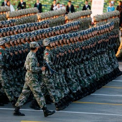 Chinese female military personnel march during a parade commemorating the 70th anniversary of Japan's surrender during World War II held in front of Tiananmen Gate, in Beijing, Sept. 3, 2015.