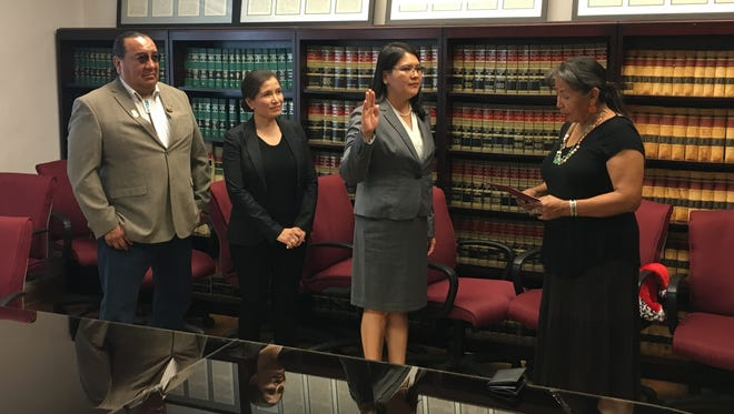 From left, Navajo Nation Council Delegate Raymond Smith Jr. and Navajo Nation Attorney General Ethel Branch attended a ceremony for Gertrude Lee, third from left, as she takes the oath of office from Window Rock District Court Judge Geraldine Benally on Monday in the Navajo Nation Attorney General's conference room in Window Rock, Ariz.
