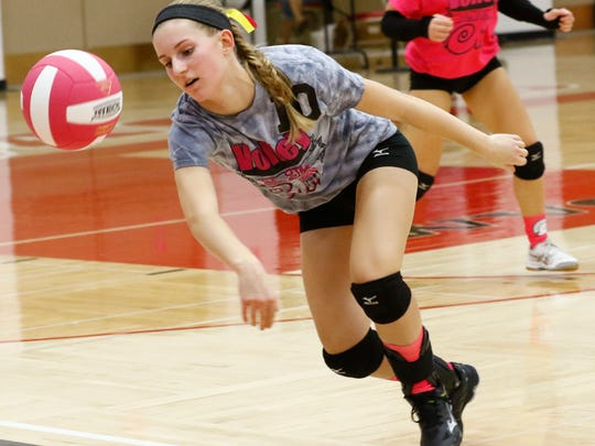 West's Kirsten Bachand(10) stumbles to retrieve the ball Thursday night during 'The Pink Game' for cancer awareness volleyball match against East at Wausau East High School.