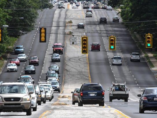 Paved and unpaved lanes stripe Wade Hampton Boulevard