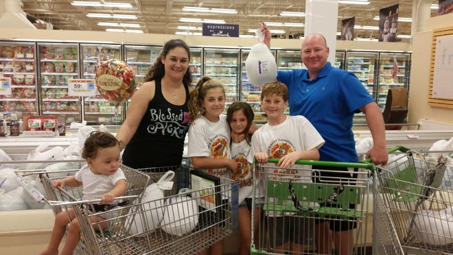 Malerie Hentschel, left, Marlena Hentschel, Shyli McDaniel, Addisyn Thurn, Tanner Thurn and Todd Thurn are seen shopping for last year's Space Coast Basket Brigade.