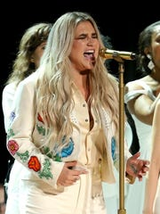 """Kesha performs """"Praying"""" at the 60th annual Grammy"""