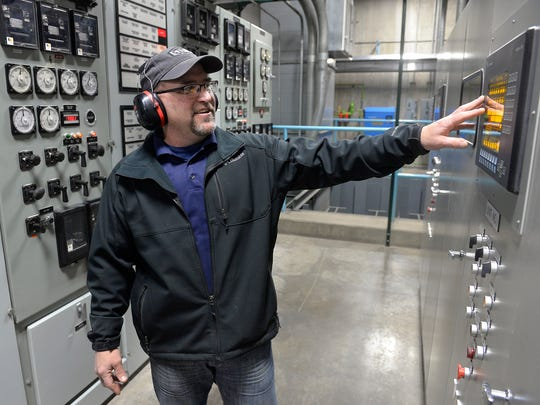St. Cloud Hydroelectric Dam Plant Supervisor Daryl Stang looks at a monitor in the control room Wednesday, Dec. 2 before performing a cleaning procedure on the trash racks. Debris flowing down river collects in the racks and needs to be removed periodically to keep water flowing smoothly into the generators.