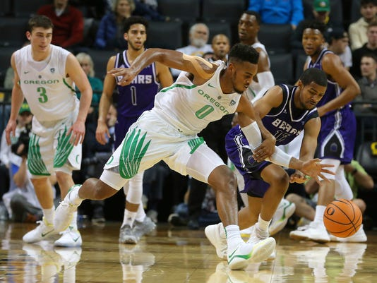 Oregon forward Troy Brown Jr. (0) and Central Arkansas guard Darraja Parnell vie for a loose ball during the first half of an NCAA college basketball game in Eugene, Ore., Wednesday, Dec. 20, 2017. (Brian Davies/The Register-Guard via AP)