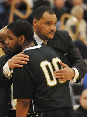 Arlington coach Bill Benjamin hugs Darius Spurling as the starters came off the floor in the fourth quarter as Mt. Vernon defeated Arlington 74-47  in sectional final action at Mt. Vernon High School in Fortville Monday March 4, 2013.
