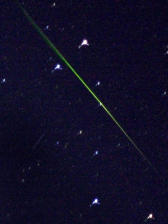The green streak of a meteor seen in the southern