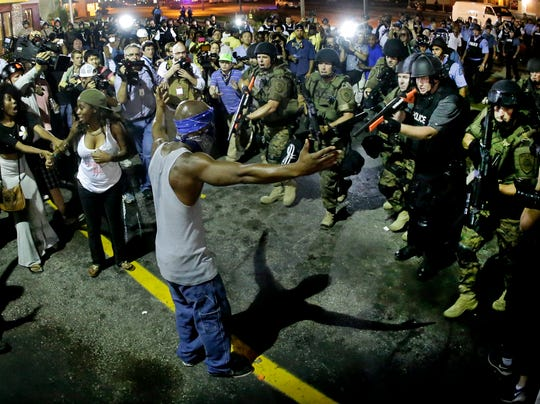 Feds to investigate Ferguson, Mo., police