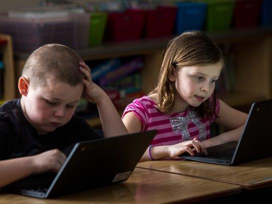 Third-grade students Savannah Moore and David Groh,
