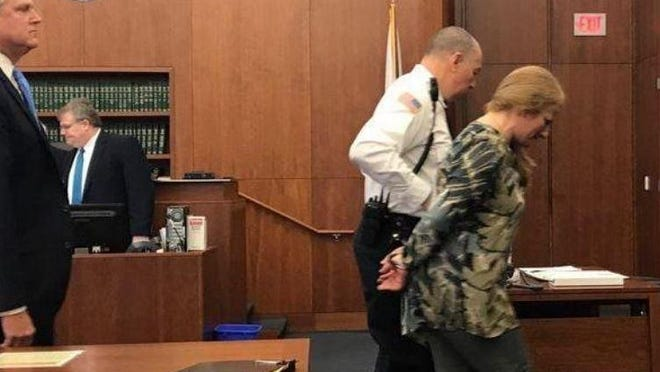 Brianna St. Peter is led out of a Plymouth courtroom in 2017. She pleaded guilty in October to five drug charges, including trafficking fentanyl.
