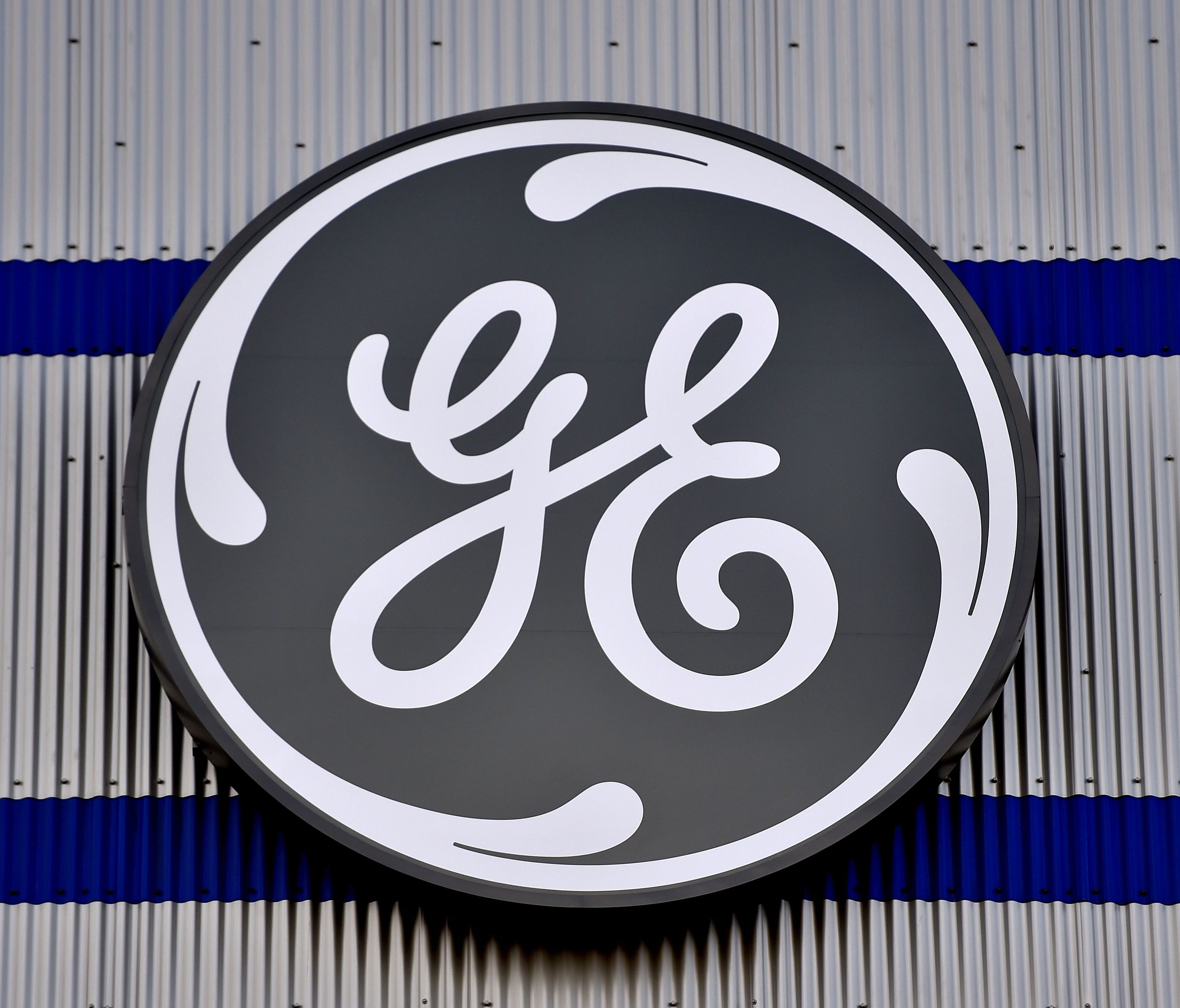 (FILES) In this file photo taken on November 21, 2016 the logo of US company General Electric is seen at a factory of the group,  in Montoir-de-Bretagne, western France.    French Labour Minister Muriel Penicaud said on June 17, 2018 that General Elec