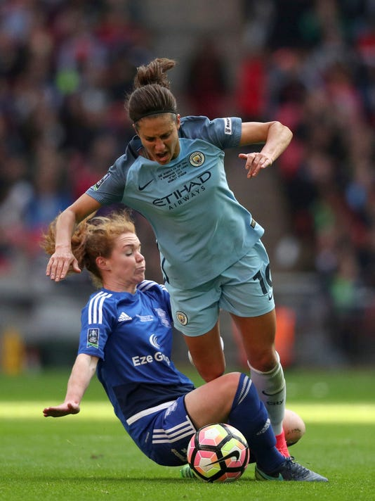 Birmingham City's Aoife Mannio, left, and Manchester City's Carli Lloyd battle for the ball during the Women's FA Cup soccer final at Wembley Stadium, London, Saturday May 13, 2017. (Adam Davy/PA via AP)