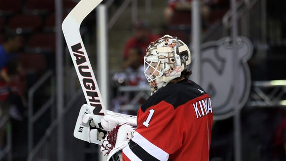 New Jersey Devils goalie Keith Kinkaid (1) stands near the net during the first period of an NHL hockey game against the Washington Capitals Monday, Sept. 18, 2017, in Newark, N.J. (AP Photo/Mel Evans)