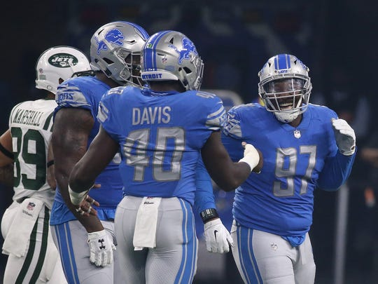 Lions defensive lineman Akeem Spence (97) celebrates