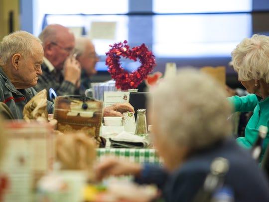 People eat lunch at the Cedar City senior citizen center, Wednesday, Feb. 10, 2016.