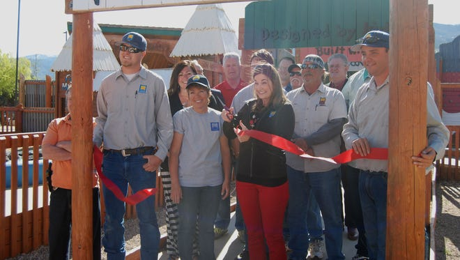 Mayor Maile Wilson and city staff cut the ribbon during the re-opening of Park Discovery Friday, April 22.