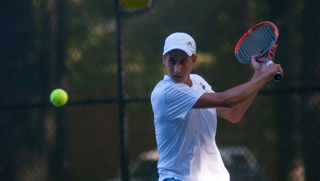 Huskies' Chris Adams readies a hit Monday, Sept. 12, during boys tennis action at Sanborn Park tennis courts.