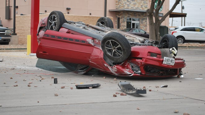A 2007 Ford Mustang struck a curb and flipped over in the early morning hours of March 9th, 2017 on 202 N Abe St outside Popeyes Chicken.