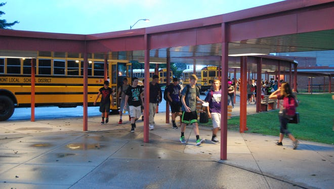 Students arrive for the last first day of school at Glen Este High School. Students arrive for their first day of school at Glen Este High School.