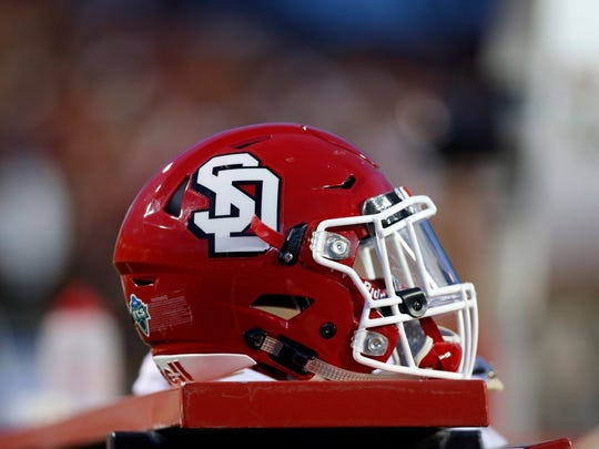 A South Dakota helmet sits in the bench during an NCAA college football game against New Mexico in Albuquerque, N.M., Thursday, Sept. 1, 2016. (AP Photo/Andres Leighton)