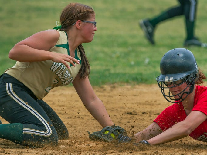 Pinelands'  Kurstin Binshedler puts the tag on Jackson Memorial's Kara Molnar for the first out in the seventh inning during  Jackson Memorial vs Pinelands in Ocean County Softball Tournament Final on May 10, 2013 in Toms River, NJ. Peter Ackerman/Staff Photographer