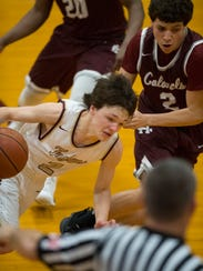 Webster County's Tyler Camplin (2) drives around Henderson's