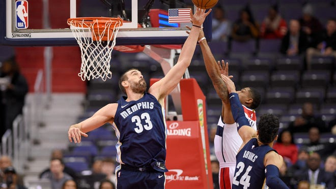 Memphis Grizzlies center Marc Gasol, left, of Spain, and forward Dillon Brooks, right, battle for the ball against Washington Wizards guard Bradley Beal, center, during the first half of an NBA basketball game, Wednesday, Dec. 13, 2017, in Washington. (AP Photo/Nick Wass)