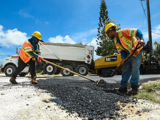 Hawaiian Rock Products employees work on a street in Dededo in this file photo from June 1, 2018.