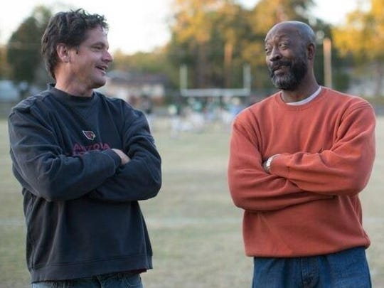 "Former Alabama, Dolphins great Tony Nathan visits with Kevin Downes, director of the new movie, ""Woodlawn."""