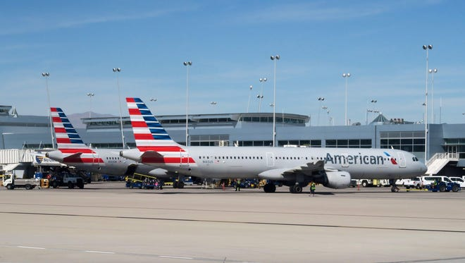 This file photo taken on February 15, 2017 shows American Airlines planes sitting at the gate on the tarmac of McCarran International Airport in Las Vegas, Nevada.