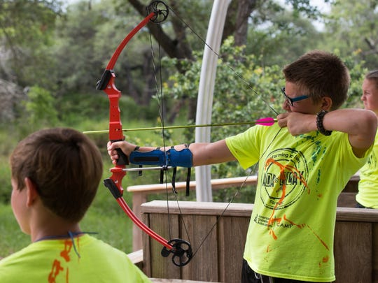 Thirteen-year-old Ethan Smith fires a bow and arrow during the fourth day of Camp Sandcastle, a camp for children with type 1 diabetes at Camp Aranzazu in Rockport, Thursday, June 30, 2016.