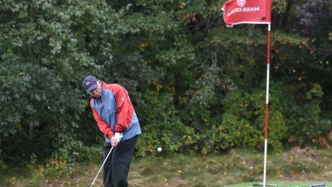 Ray Richard, from Willowbend, follows a chip shot onto the 10th green in soggy first-day action in the Massachusetts Senior Amateur Championship.