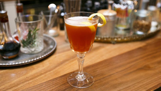 A Paper Airplane cocktail at Archive Coffee & Bar is made with bourbon, Aperol and Ramazzotti Amaro.