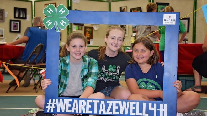A Tazewell County 4-H Federation member is pictured with younger 4-H-ers she was mentoring during 4-H Show judging.