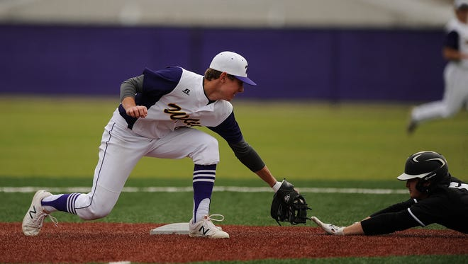 Wylie's Mason Schubert (47) tags out Wichita Falls Rider baserunner Deven Smith (6) stealing second base during the top of the fourth inning of the Bulldogs' 6-1 loss n the Abilene Invitational baseball tournament on Saturday, March 11, 2017, at Wylie High School.