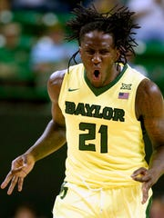 Baylor forward Taurean Prince reacts to a three-point