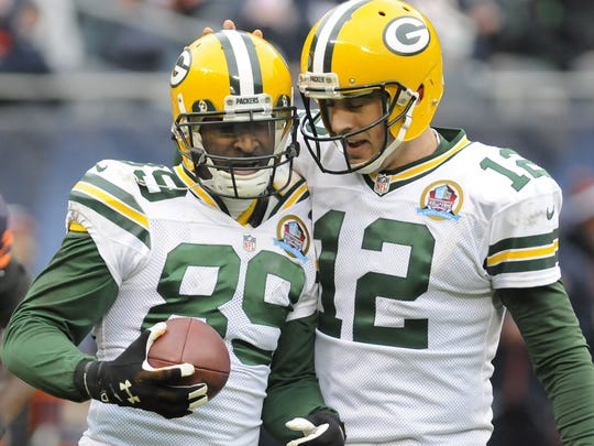 Green Bay Packers quarterback Aaron Rodgers, right, congratulates receiver James Jones after a second-quarter touchdown against the Chicago Bears at Soldier Field in 2012.