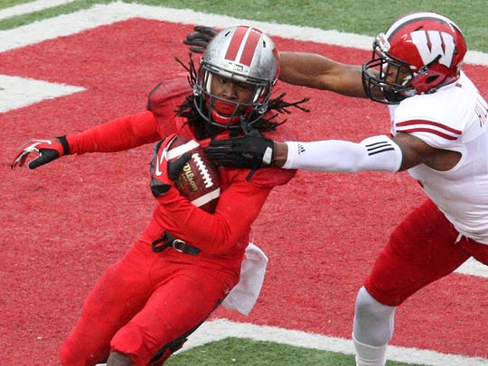 Rutgers senior Janarion Grant returns a kickoff against