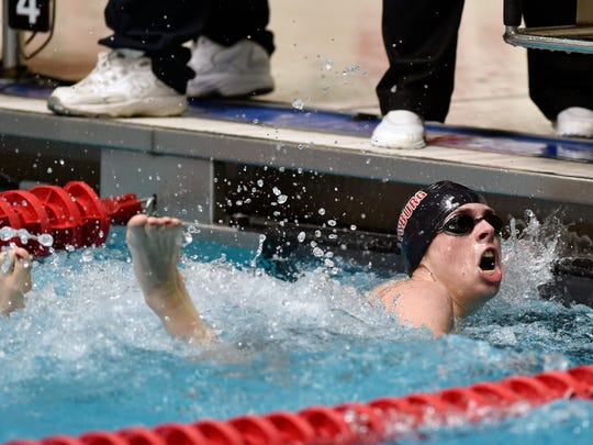 Gettysburg's Jared Herr looks at the scoreboard after finishing first in the 200-yard freestyle in the District 3 Class 2A boys swimming championships Friday, March 3, 2017, at Cumberland Valley High School.