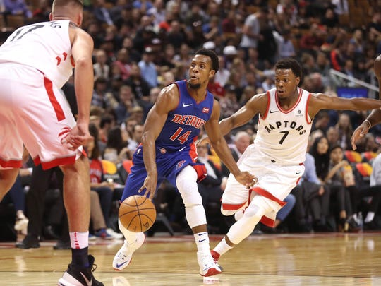 Pistons guard Ish Smith (14) dribbles as Raptors point guard Kyle Lowry (7) defends during the Pistons' 116-94 exhibition loss on Tuesday, Oct. 10, 2017, in Toronto.