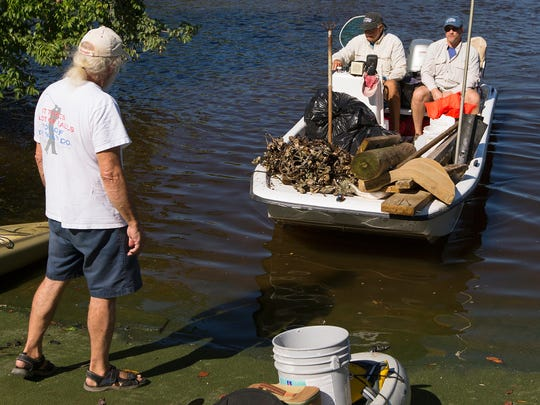 Volunteers return to the Mound House on Fort Myers Beach on Saturday during the Keep Lee County Beautiful Cleanup event.Fifty volunteers removed more than 3,000 pounds of debris and 4 pounds of monofilament from mangrove areas.