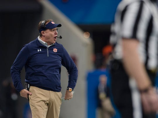 Auburn head coach Gus Malzahn screams during the first half of the Peach Bowl between Auburn and Central Florida on Monday, Jan. 1, 2018, at Mercedes-Benz Stadium in Atlanta, Ga.