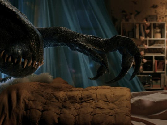 "A dinosaur stalks a little girl in her room in the sequel ""Jurassic World: Fallen Kingdom,"" in theaters June 22."