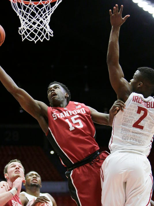 Stanford's Marcus Allen (15) shoots against Washington State's Ike Iroegbu (2) during the first half of an NCAA college basketball game Thursday, Feb. 18, 2016, in Pullman, Wash. (AP Photo/Young Kwak)